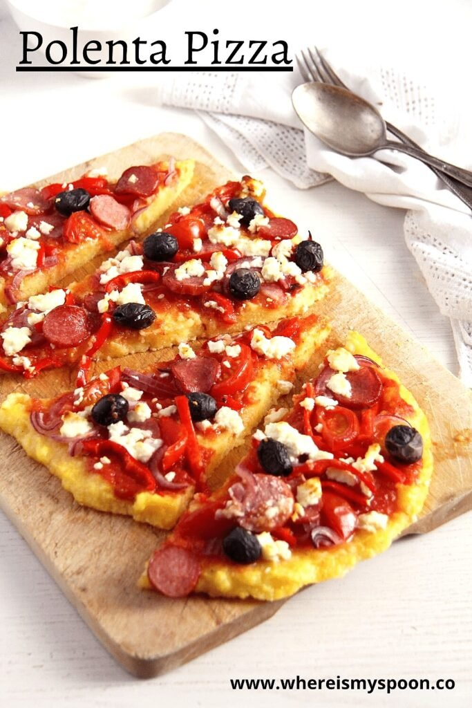 cornmeal pizza topped with sausage, cheese and olives