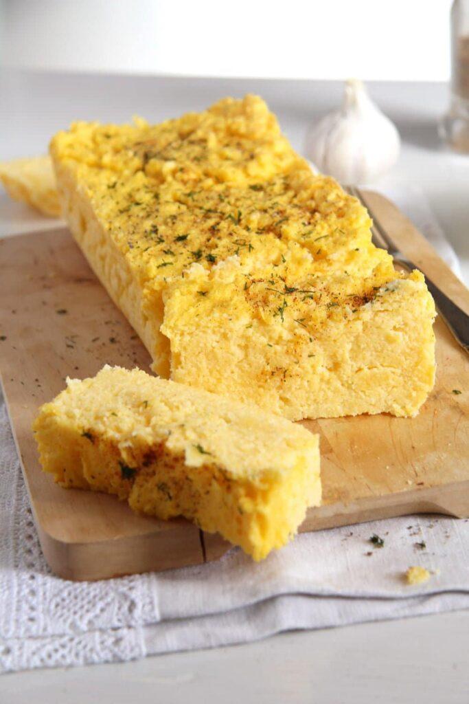 polenta souffle 683x1024 Romanian Polenta Souffle with Cheese and Garlic Sauce