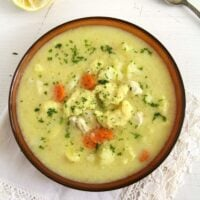 chicken cauliflower soup with flour dumplings ready to be served