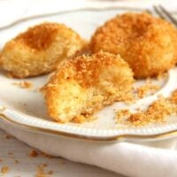 soft dumplings coated with breadcrumbs on a plate