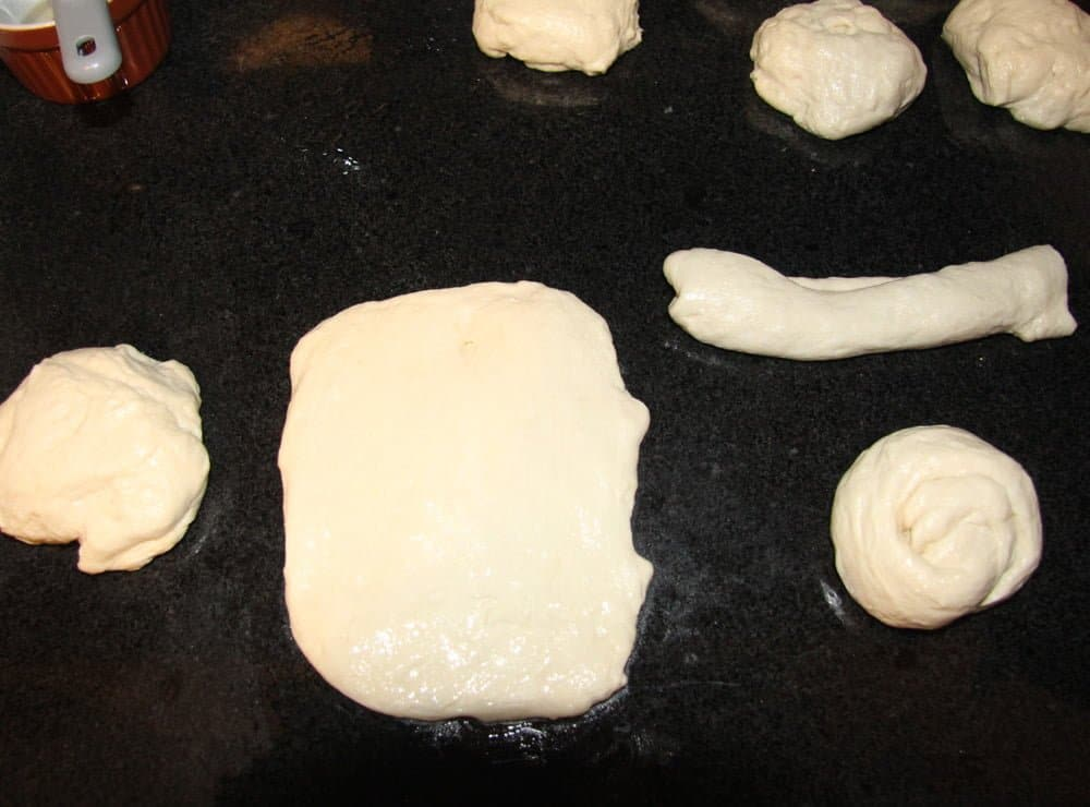 forming yeast dough into crescent rolls