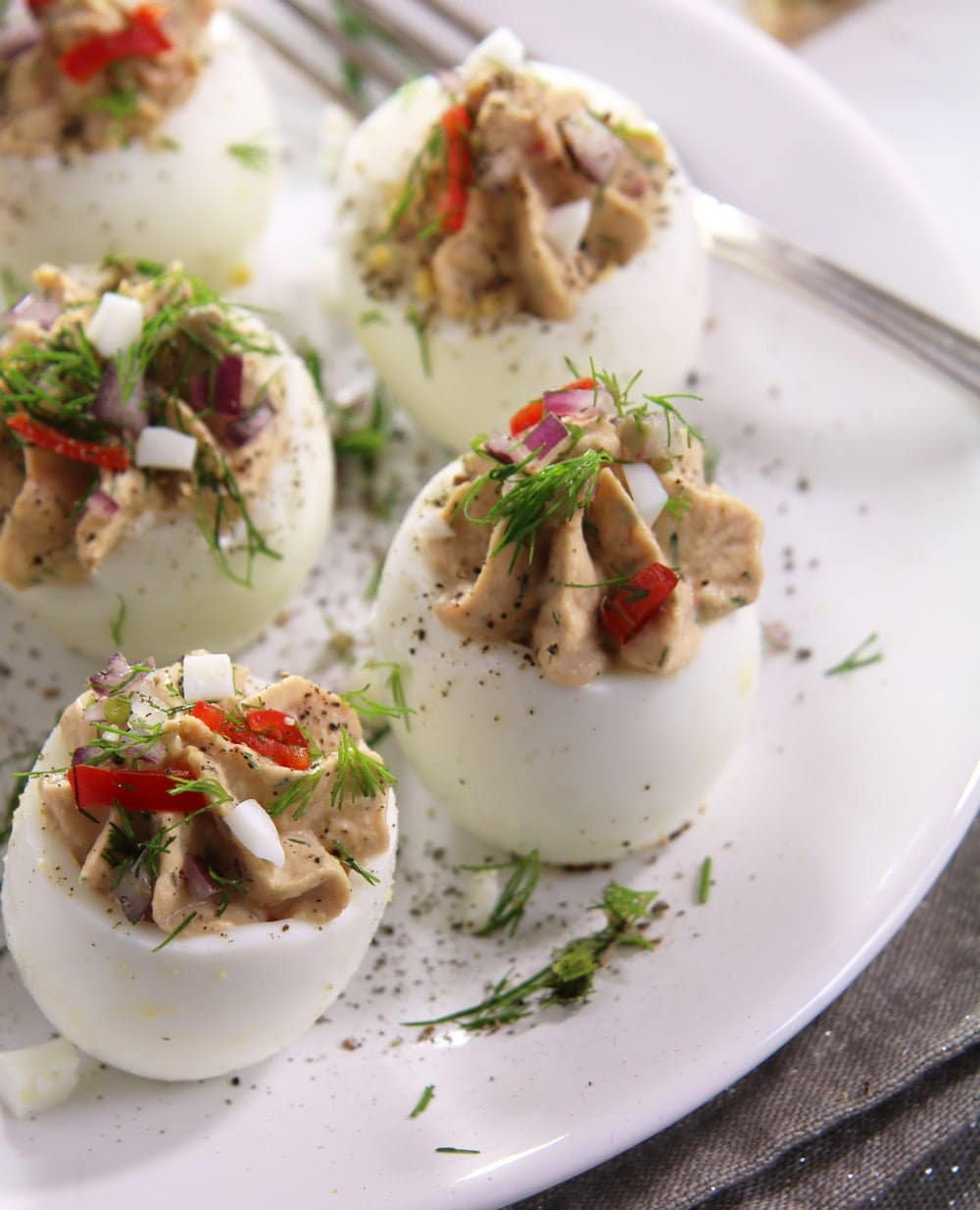 spicy eggs filled with tuna fish and capers