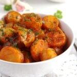 new potatoes stewed in marinara sauce with garlic