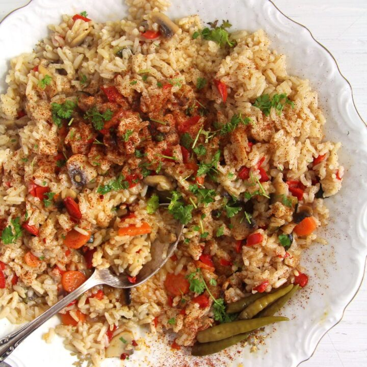 vegan romanian rice served with a silver spoon