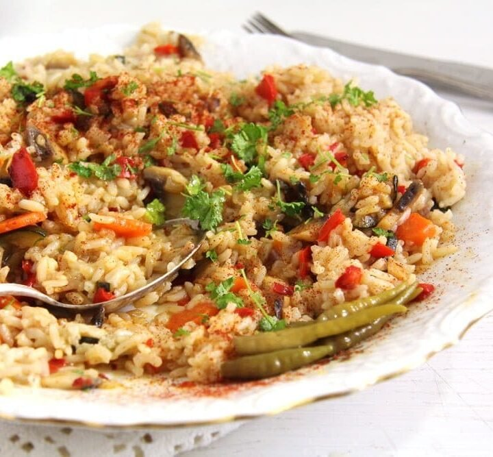 romanian rice with vegetables served on a vintage plate