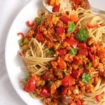 soy granules pasta sauce with spaghetti on a plate