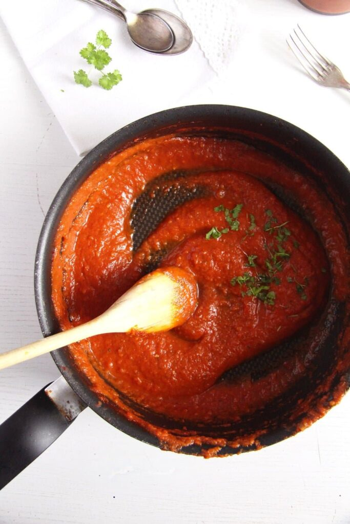 spicy marinara sauce cooked in a black saucepan
