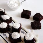 coconut milk and coconut cream brownies on a vintage platter