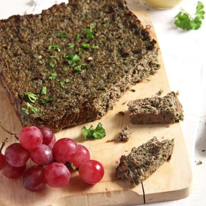 romanian easter drob served with grapes on a wooden board