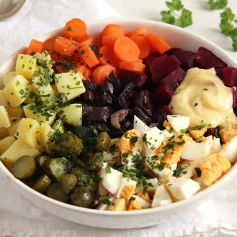 salad russe with carrots, potatoes, gherkins, eggs, beets and mayo