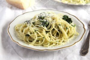 plate with pasta with spinach