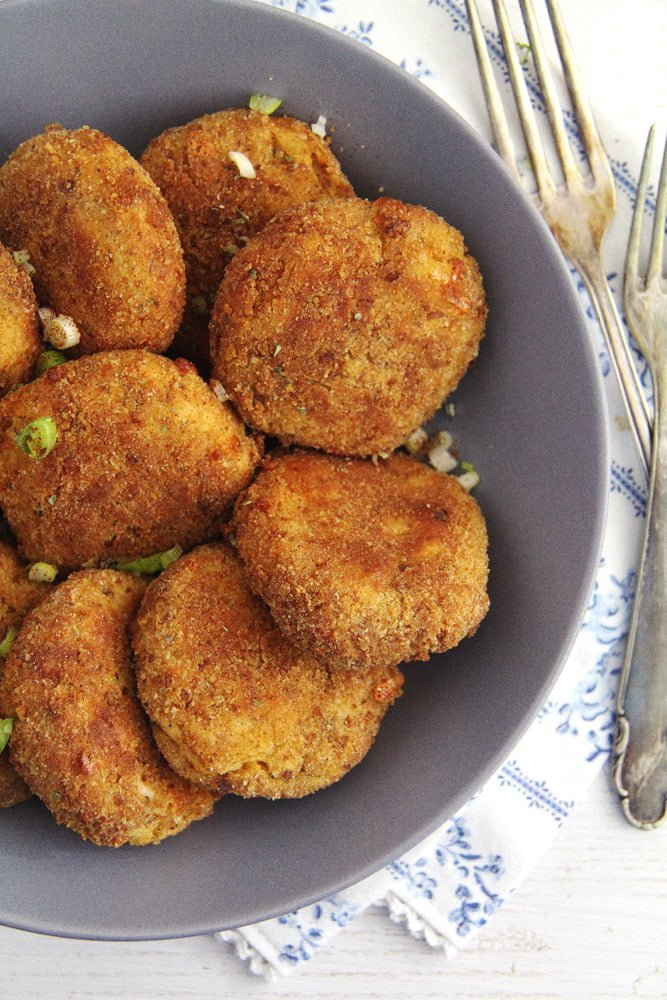 baked cauliflower patties crispy on the outside served in a bowl