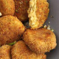 golden and crispy potato cauliflower patties close up