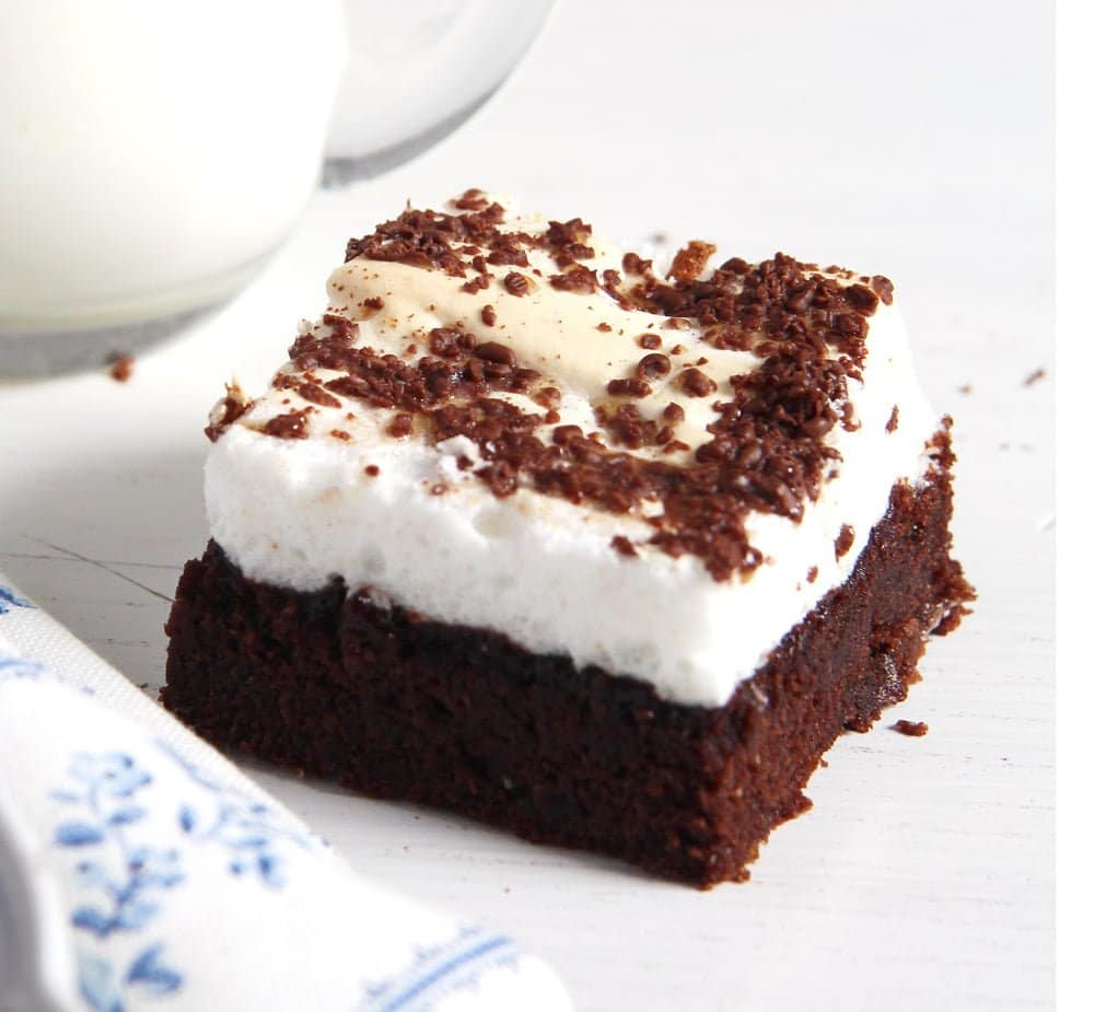 one brownie topped with grated dark chocolate and egg whites.