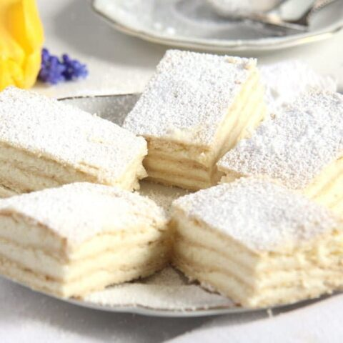 romanian lemon cake sliced on a vintage plate