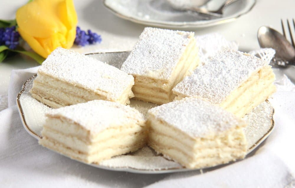 romanian lemon cake sliced on a vintage plate