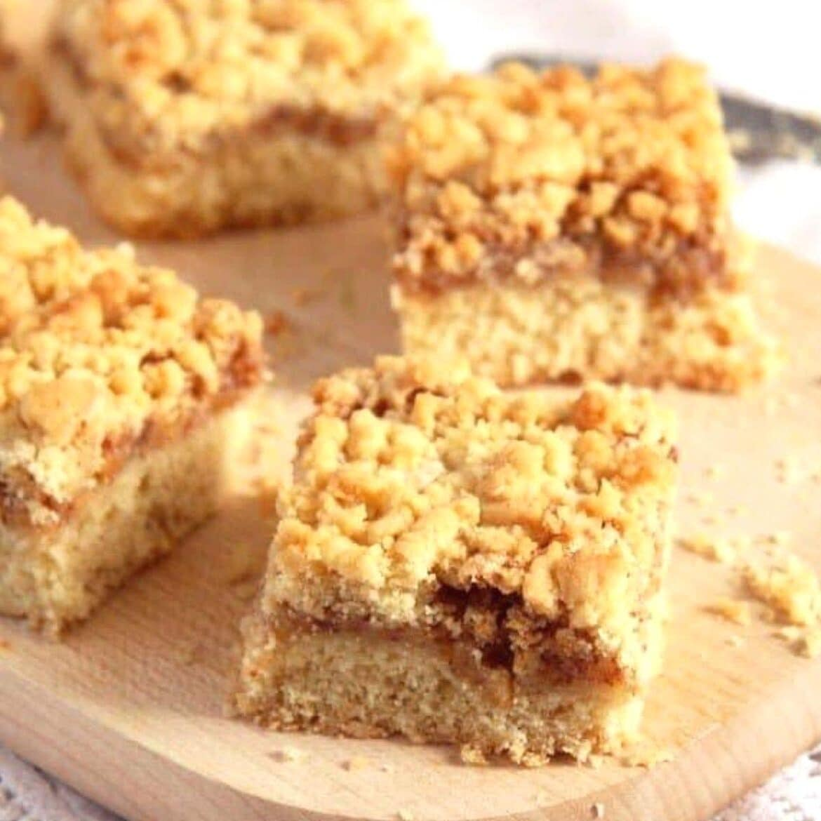 apricot jam cake with crumbles cut into squares