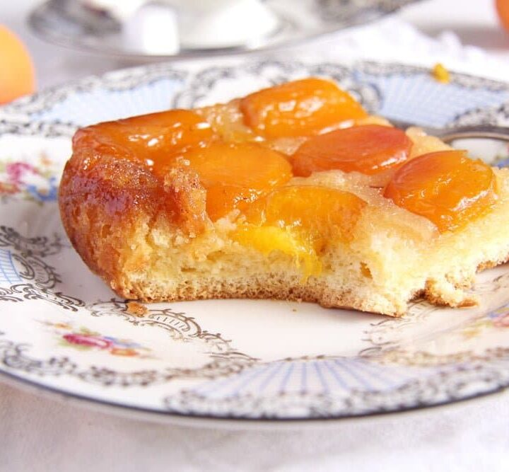 eating a slice of upside down apricot cake