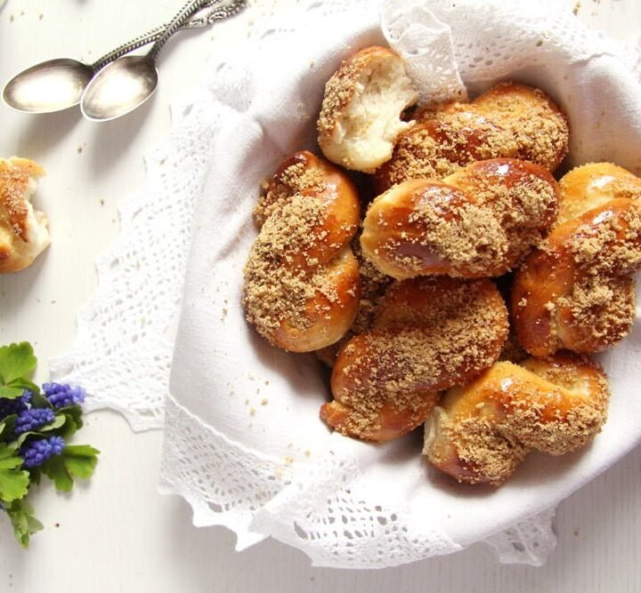 mucenici or romanian pastries in a basket lined with linen