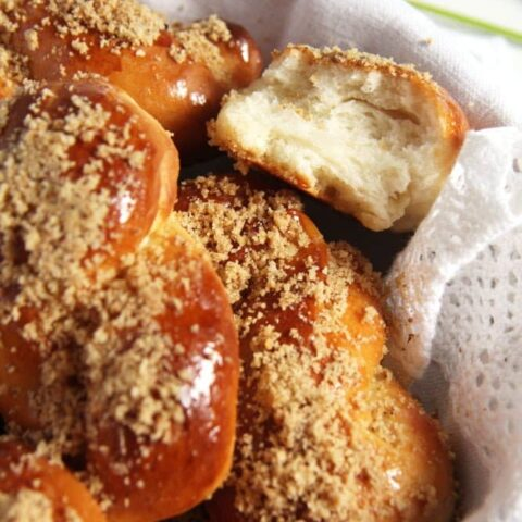 fluffy romanian pastries sprinkled with walnuts in a basket