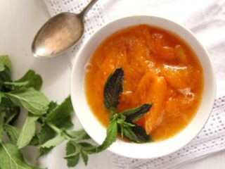 fresh or canned apricot sauce in a small white bowl overhead shot