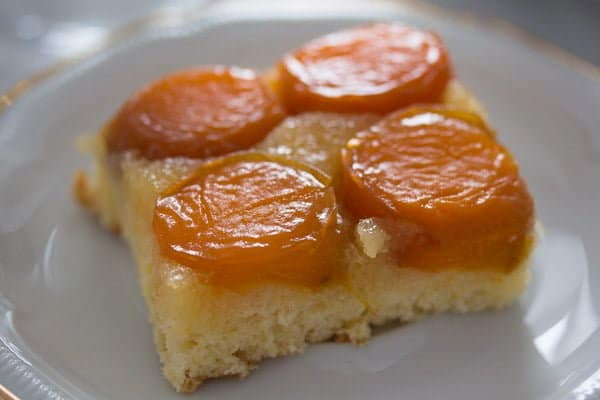 fresh apricot cake slice on a small coffee plate
