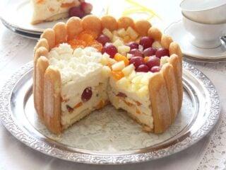 romanian diplomat cake or charlotte torte cut on a silver platter