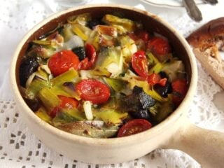 vegan leek stew with olives in a small pot