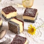 romanian tosca cake square cakes and yellow flowers on the table
