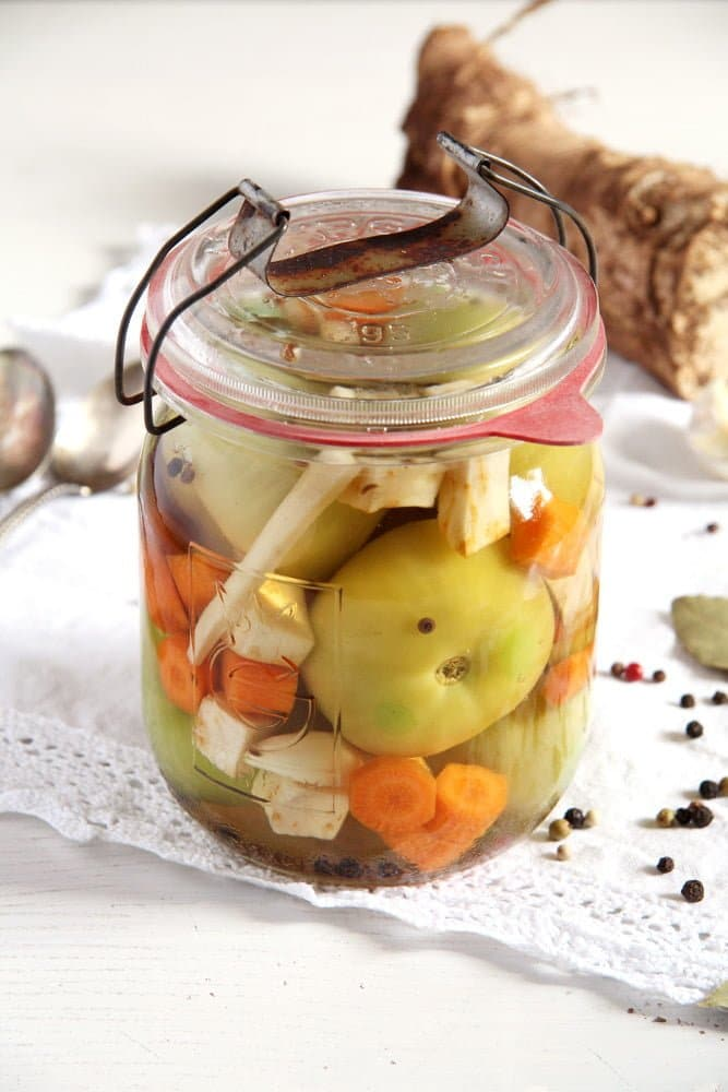 unripe green tomatoes pickled in a jar