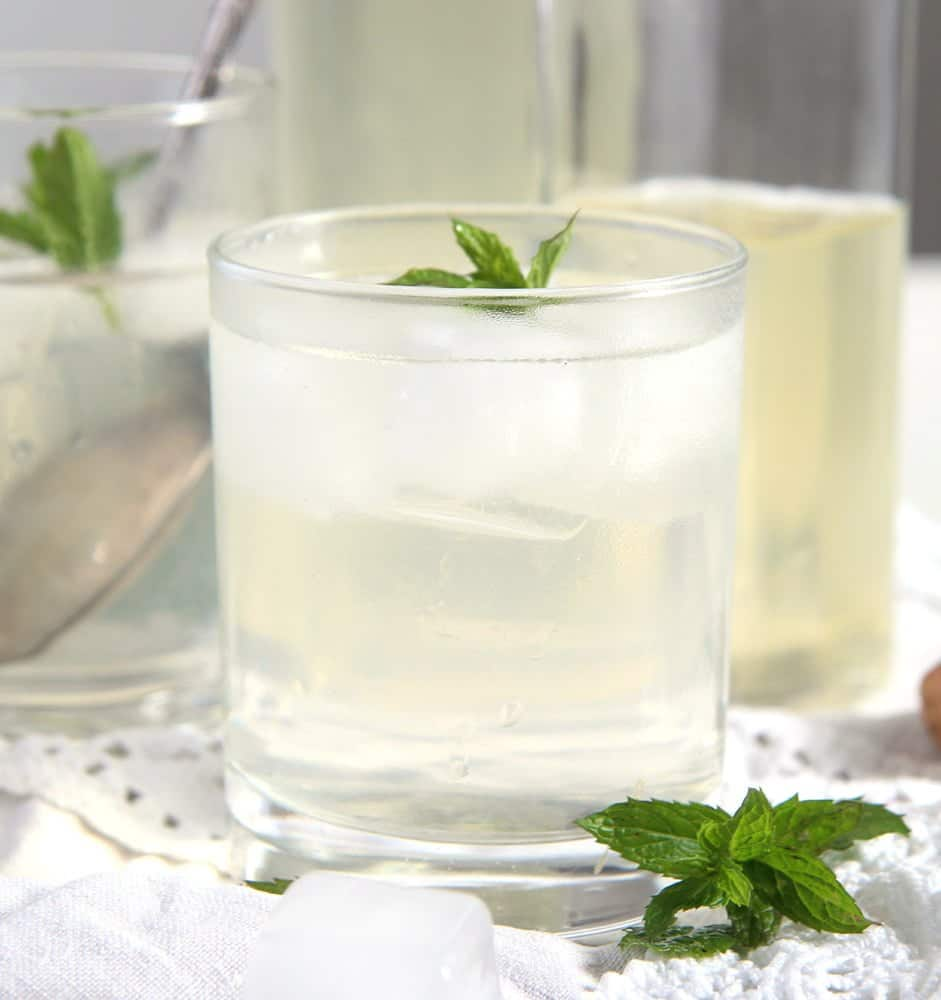 close up with lemon mint syrup on ice