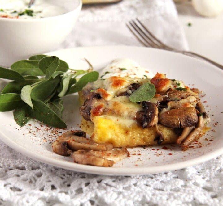 slice of mushroom polenta casserole with sage on a small plate