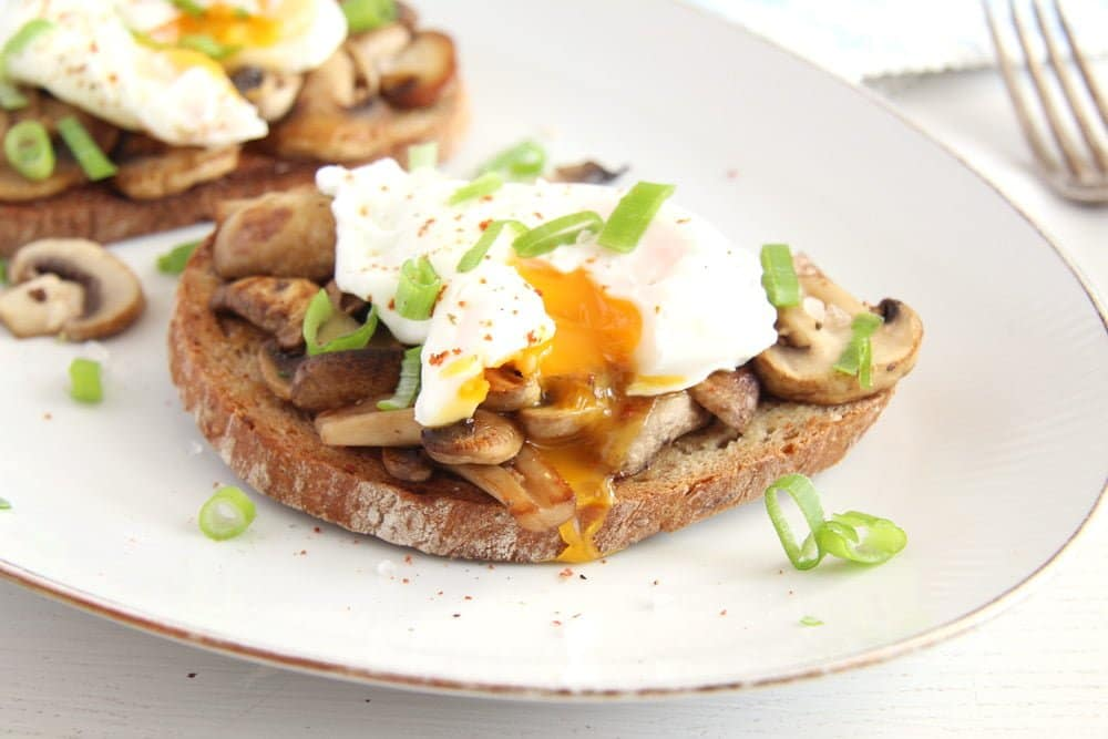 garlic mushroom toast with poached eggs