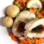 plate with fish, vegetables and whole potatoes