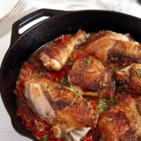 chicken in the skillet with garlic red pepper sauce