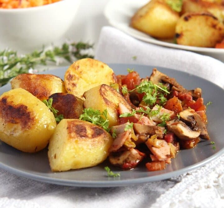 gypsy potatoes fried with bacon and ham and served with vegetables