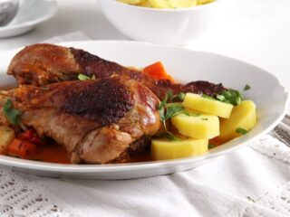platter with turkey legs served with potatoes and veggies