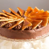 dobos torte with caramel wedges on top.