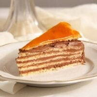 hungarian cake with chocolate buttercream sliced on a small vintage plate.