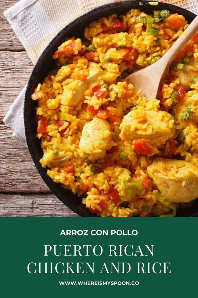 arroz con pollo in a skillet with a spoon