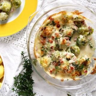 brussels sprouts bake with cream cheese sauce served with boiled potatoes