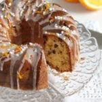 tender orange raisin bundt cake or Gugelhupf jeweled with candied orange peel, raisins, chocolate chips and almonds, an easy and quick cake for the weekend. #whereismyspoon #orangebundtcake #orangeraisincake #bundtcakerecipe #germanbundtcakerecipe #germancake