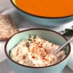 hungarian spread with feta and a bowl of carrot soup behind