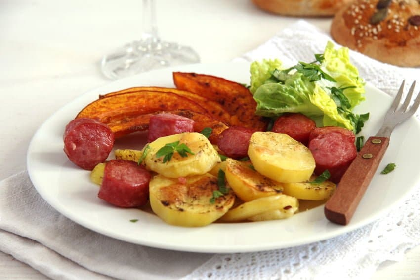 potato pumpkin sausage bake served with salad