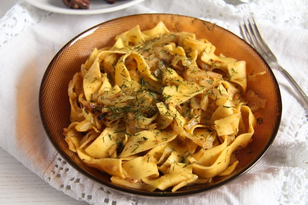 haluski with cabbage sprinkled with dill in a bowl