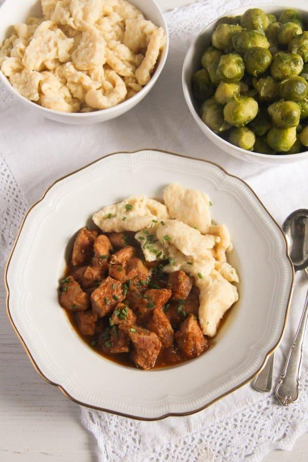 hungarian pörkölt with nokedli - pork stew with dumplings