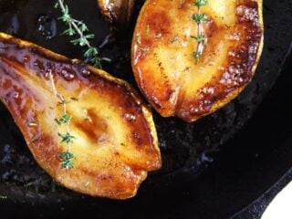shiny roasted pears halves in skillet