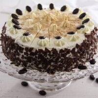 whiskey cake decorated with chocolate and whipped cream