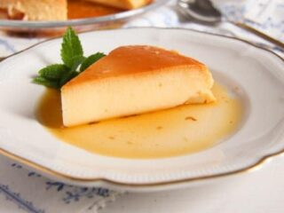 sliced flan in a pool of caramel on a plate