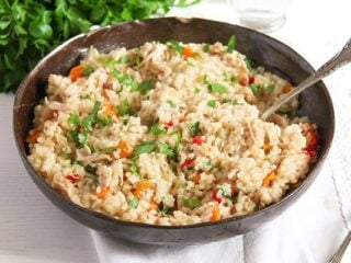 romanian pilaf with chicken in a large brown serving dish